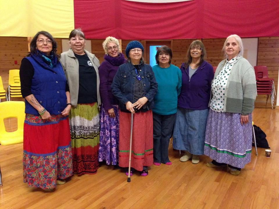 Group of older and younger women in ribbon skirts