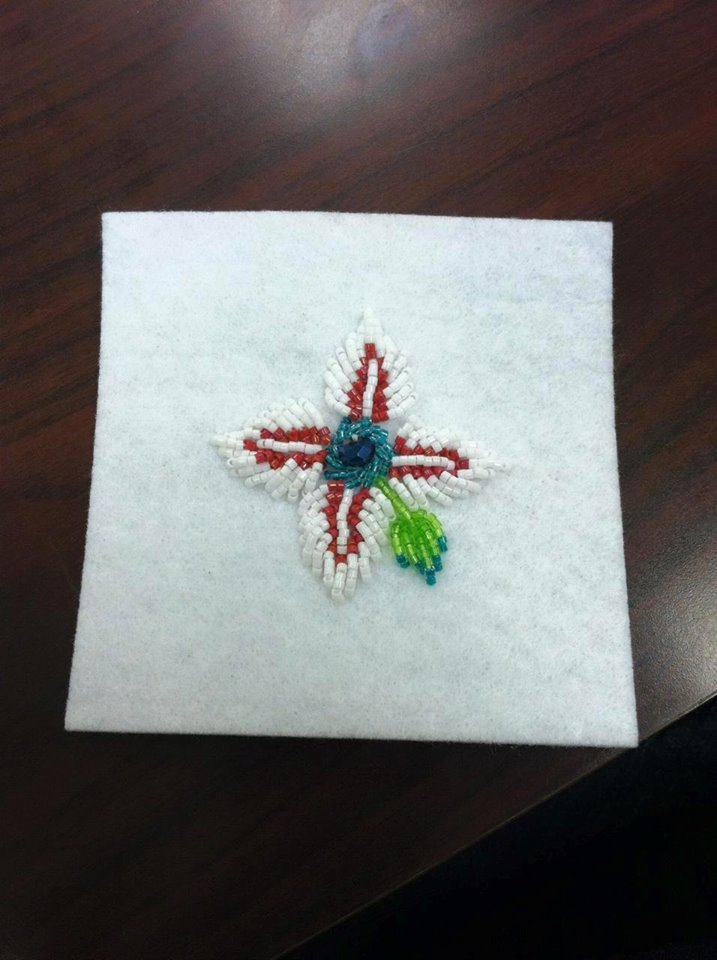 Completed beaded flower in white and red