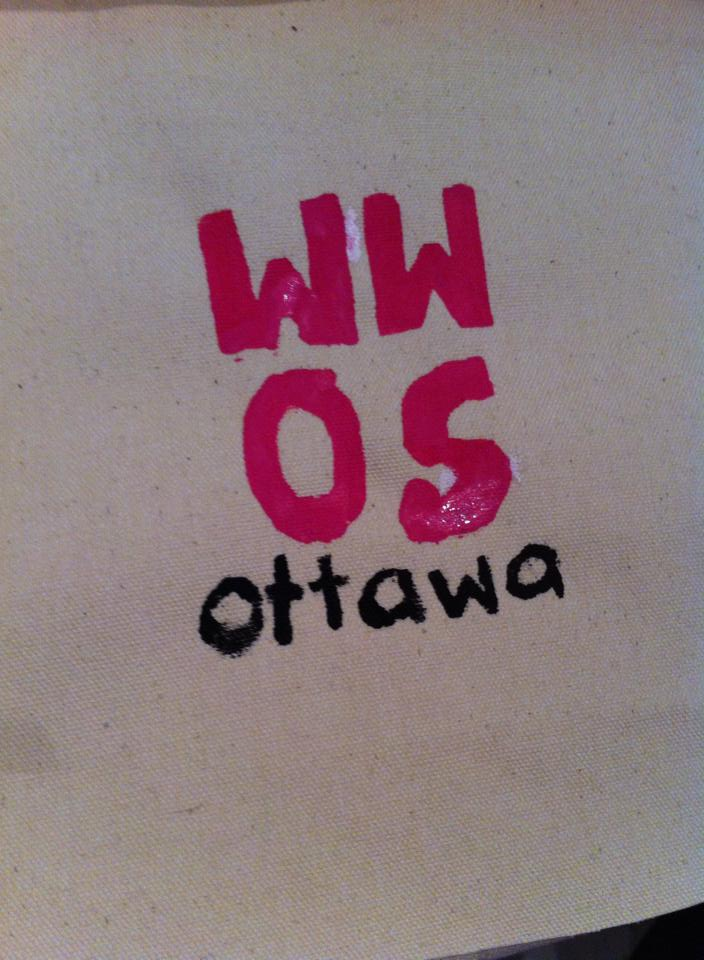 Fabric with painted letters reading WWOS Ottawa