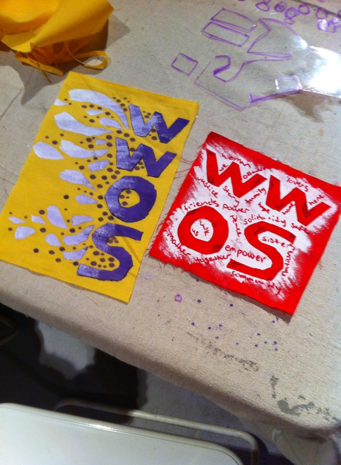2 pieces of painted fabric with painted letters WWOS