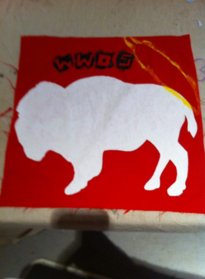 Fabric painted with a silhouette of a buffalo and the letters WWOS
